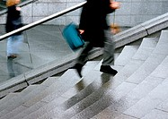 Person climbing stairs, low section, blurred motion