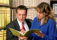 Man and woman examining document