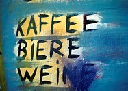 'Coffee, beer, wine' text painted in German, close-up