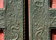 China, Beijing, Forbidden City, dragon motif carving on door