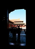 China, Beijing, doorway and silhouette of people in Forbidden City