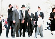 Israel, Jerusalem, group of Orthodox Jews, outside, blurred