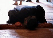 Israel, Jerusalem, person touching head to ground, blurred
