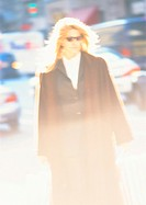 Woman in street, blurred