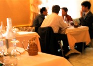 People dining in restaurant, blurred