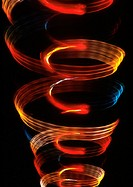 Spiraling light effect, one within the other, oranges, reds and blues