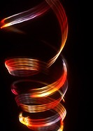 Spiraling light effect, reds and yellows