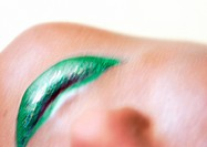 Woman wearing green lipstick, close up of mouth, blurred, upside down