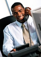 Businessman using telephone, smiling