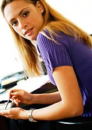 Woman using hand held computer, portrait (thumbnail)