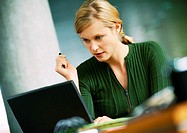 Woman looking at laptop computer