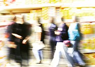 People walking and shelves in grocery store, superimposed image, blurred