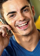 Man using cell phone, smiling, close-up
