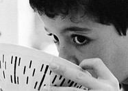 Child drinking from bowl, close-up, b&w