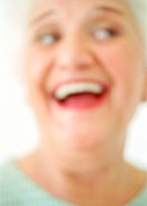 Senior woman smiling, close-up, portrait, blurred
