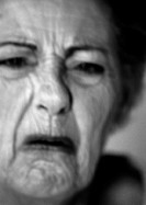 Senior woman frowning, close-up, portrait, b&amp;w