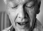 Senior man with eyes closed, close-up, b&amp;w