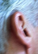 Senior man's ear, extreme close-up, blurred