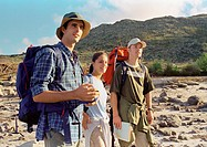 Three young people hiking