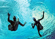 Couple swimming underwater, underwater view