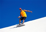 Man snowboarding, low angle view