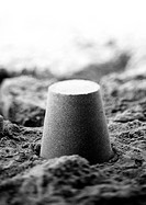 Bucket-shaped pile of sand, b&w