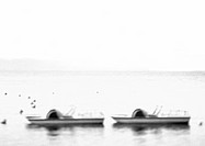 Paddle boats in water, defocused, b&w