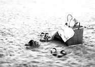Shoes and bag on the beach, b&w