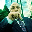 Businessman smoking cigar, portrait