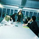 Young woman office worker standing on chair, stripping and yelling, colleagues watching