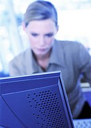 Businesswoman sitting at computer (thumbnail)