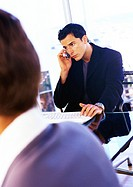 Businessman using cell phone (thumbnail)