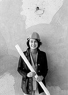 Woman wearing hard hat, portrait, b&w
