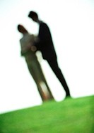 Two people in park, blurred