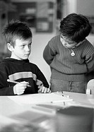 Two children, one holding pencil, b&w