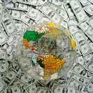 World globe on top of U S Dollars