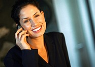 Businesswoman smiling, talking on cell phone, portrait