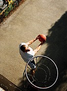Man preparing to shoot basket, overhead view