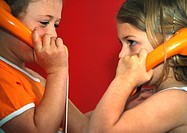 Two children with telephones, close-up