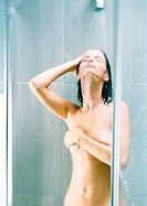 Woman taking shower, covering breast