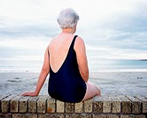 A mature woman looking at the sea