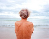 A mature man looking at the sea