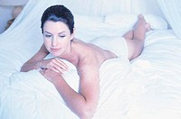 Woman lying on bed (thumbnail)