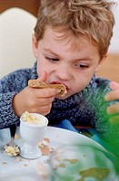 Boy eating breakfast (thumbnail)