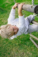 Boy climbing rope ladder