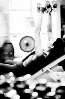 Woman weight-training