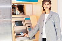 Woman at cashpoint