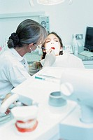 Girl being examined by dentist