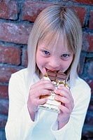 Girl eating chocolate (thumbnail)