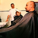 Boy and man at barbers